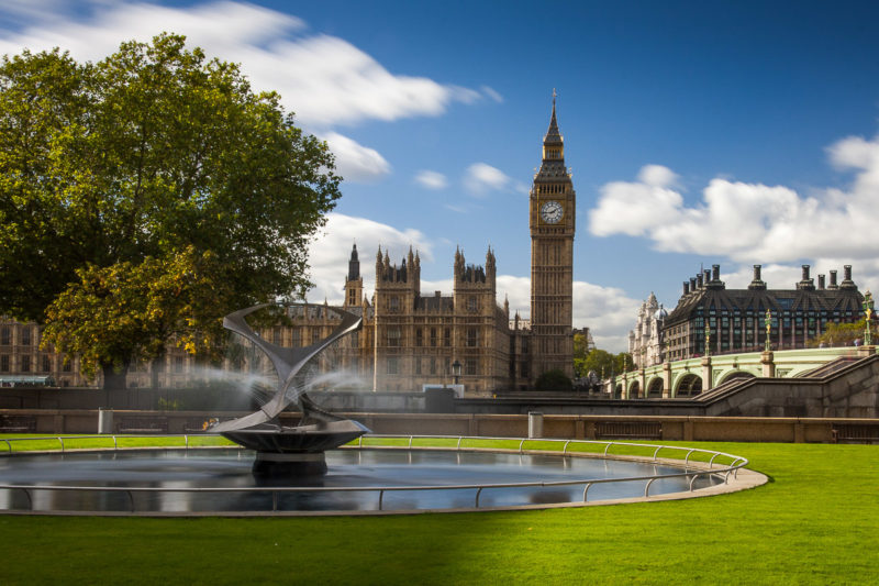 Long Exposure of Big Ben by Day in London with a fountain in the foreground.