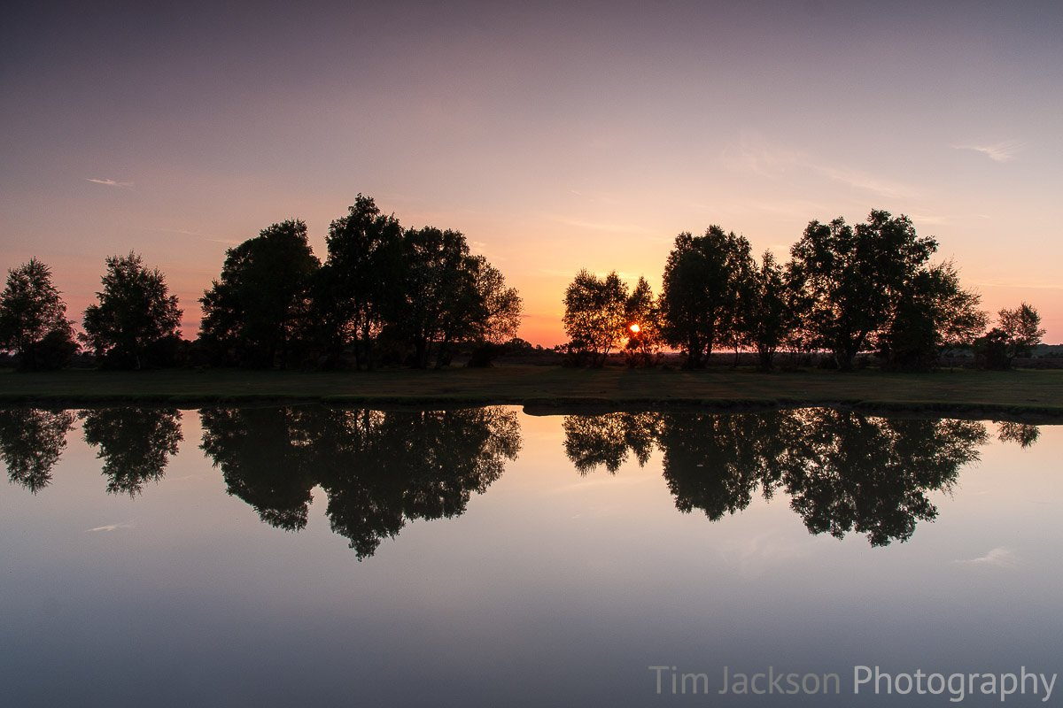 Sunset Symmetry Photograph by Tim Jackson