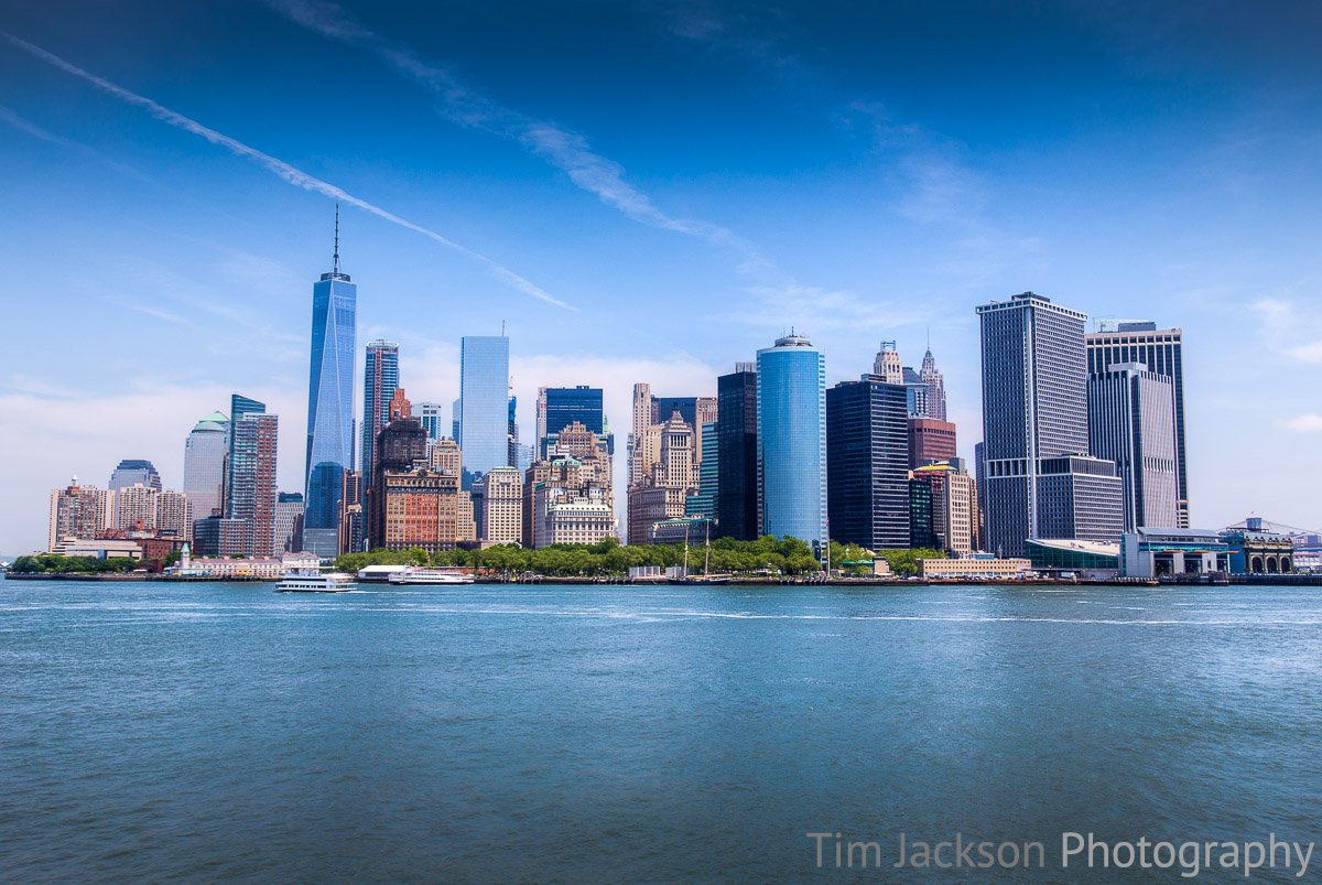 Staten Island Ferry offers views of the Statue of Liberty and Manhattan Skyline Manhattan Skyline Photograph by Tim Jackson