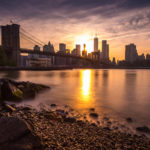 Brooklyn Bridge from Day to Dusk Sun Sets Behind Lower Manhattan Photograph by Tim Jackson