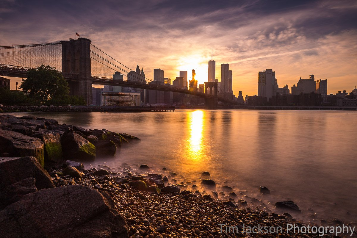 Sun Sets Behind Lower Manhattan Sun Sets Behind Lower Manhattan Photograph by Tim Jackson