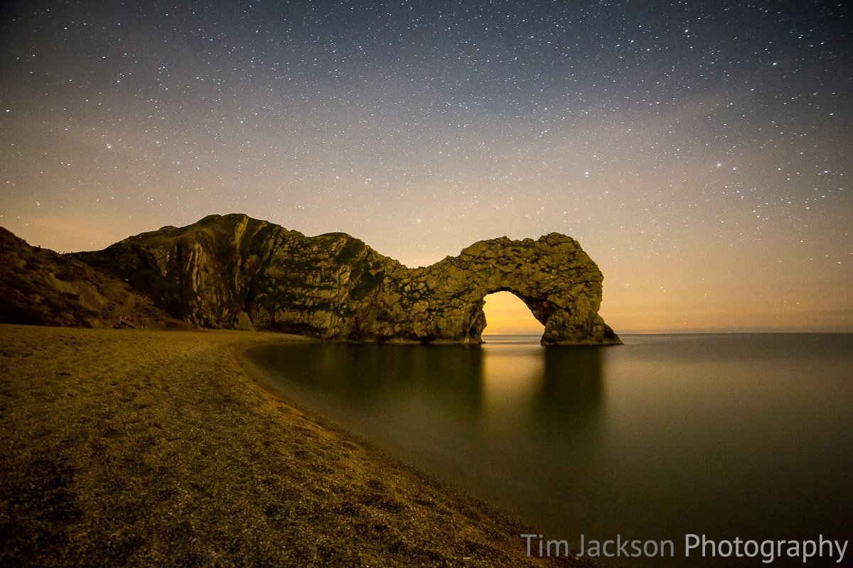 Starscape Durdle Door at Night Photograph by Tim Jackson