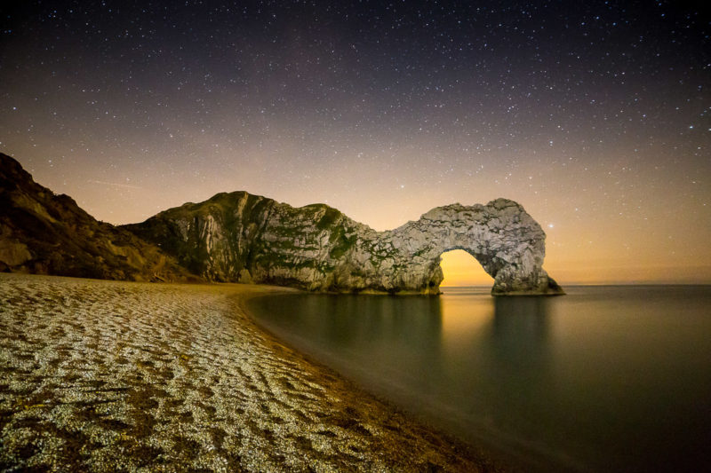 Stargazing Light Painting Durdle Door Photograph by Tim Jackson