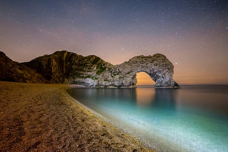 Lighting The Way to Durdle Door Lighting The Way to Durdle Door Photograph by Tim Jackson