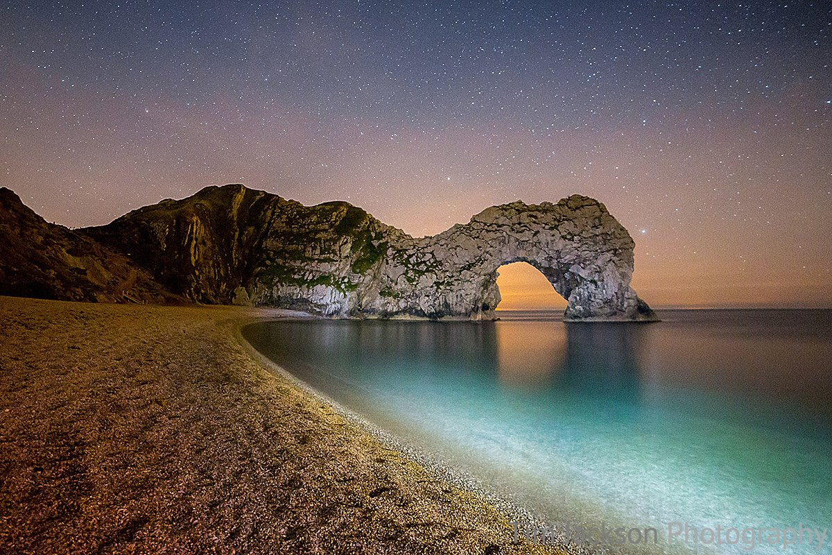 Lighting The Way to Durdle Door Photograph by Tim Jackson
