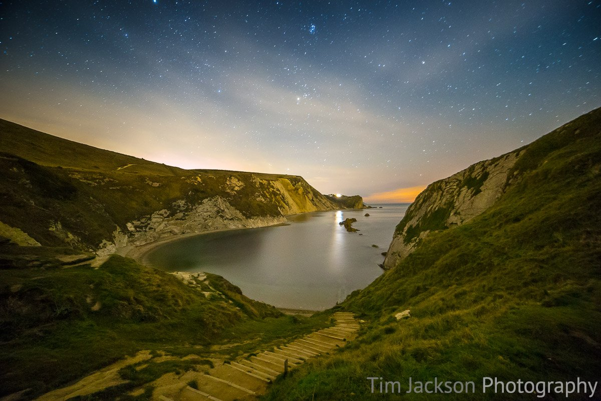 Night photography at Durdle Door Man O War Cove at Night Photograph by Tim Jackson