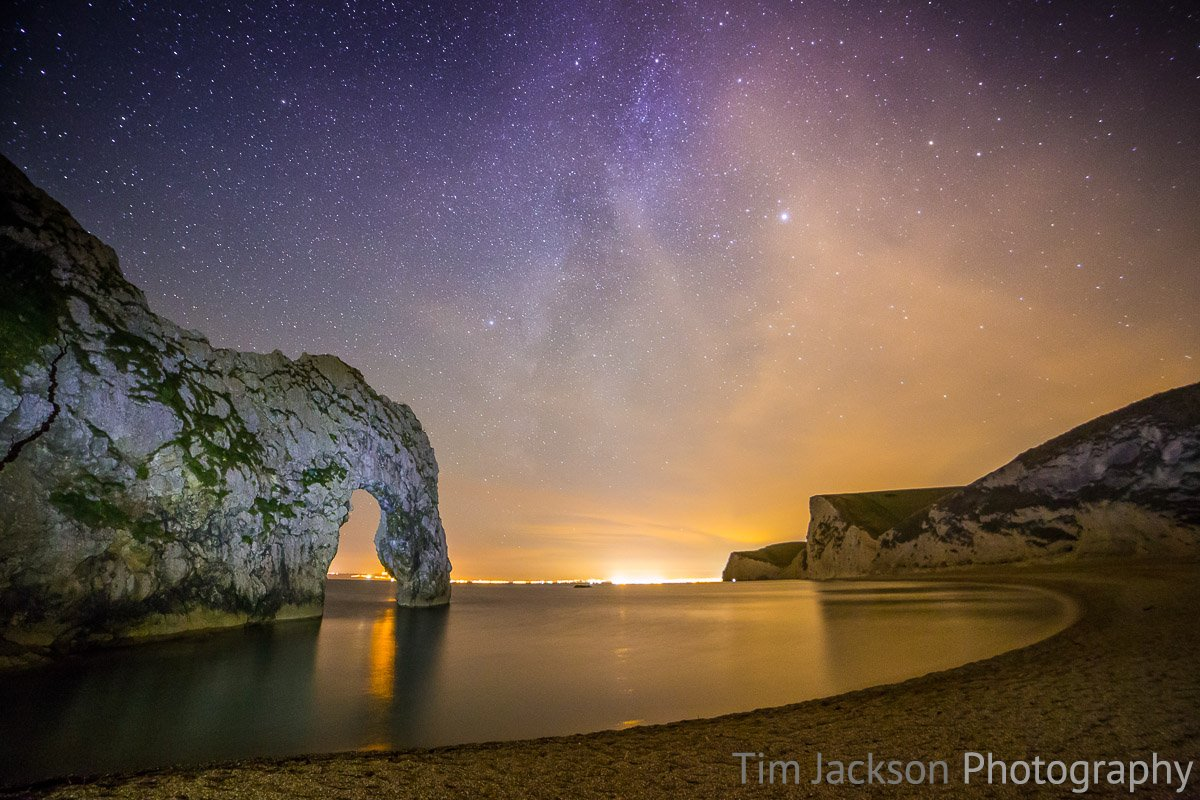 Night photography at Durdle Door Starry Skies Over Jarassic Coast Photograph by Tim Jackson