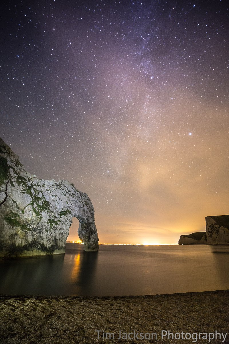 Night photography at Durdle Door Starry Skies Over Poole Photograph by Tim Jackson