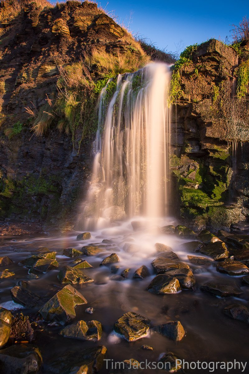 Kimmeridge Bay Waterfall Kimmeridge Bay Waterfall Photograph by Tim Jackson