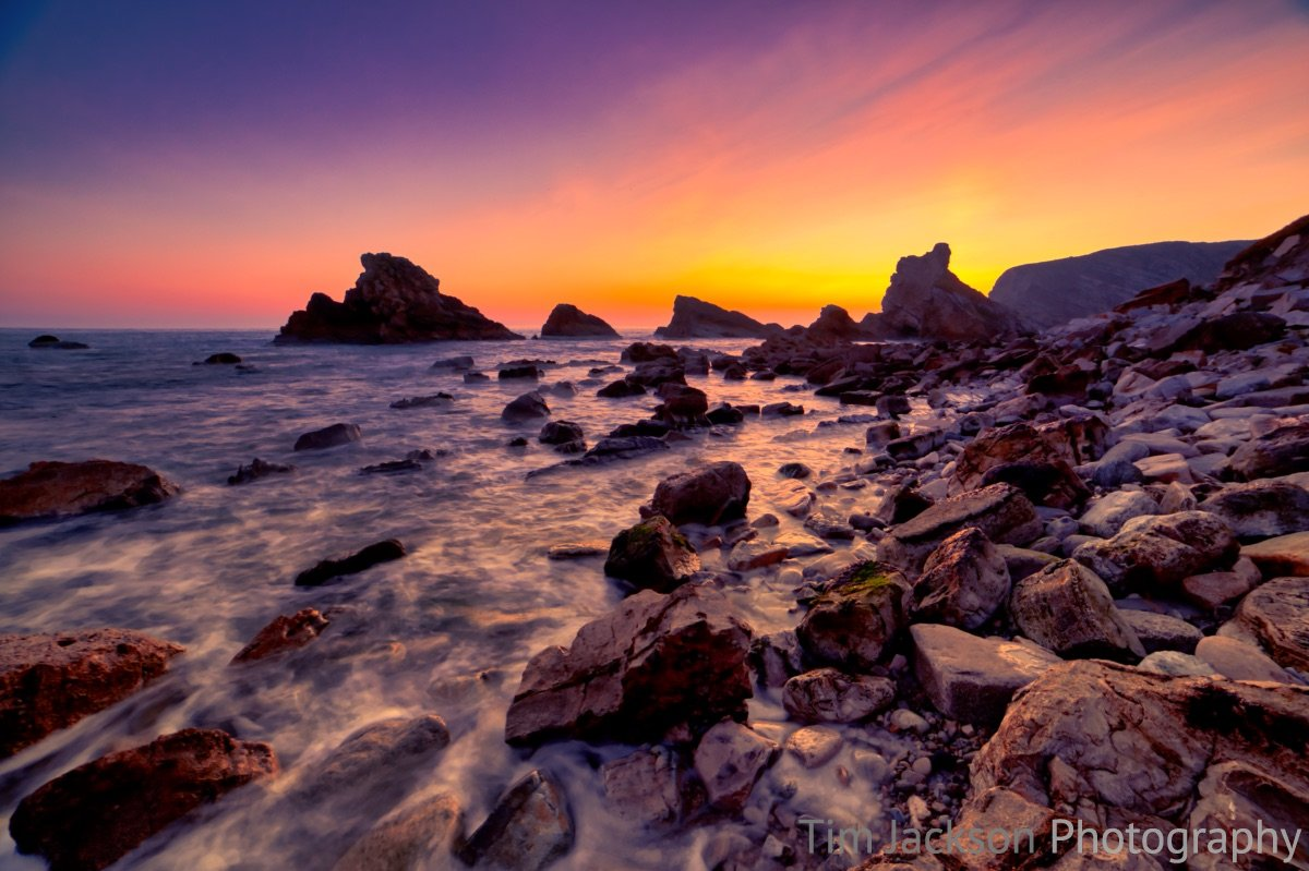 Mupe Bay Sunset Photograph by Tim Jackson