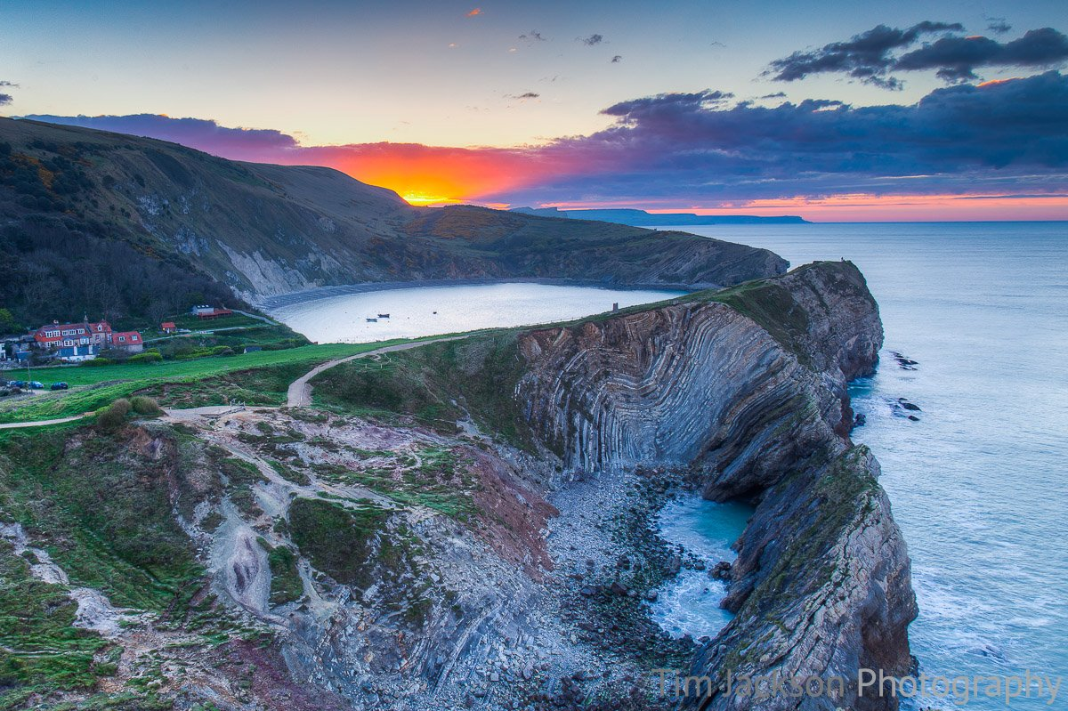 Sunrise Over Lulworth Cove Photograph by Tim Jackson