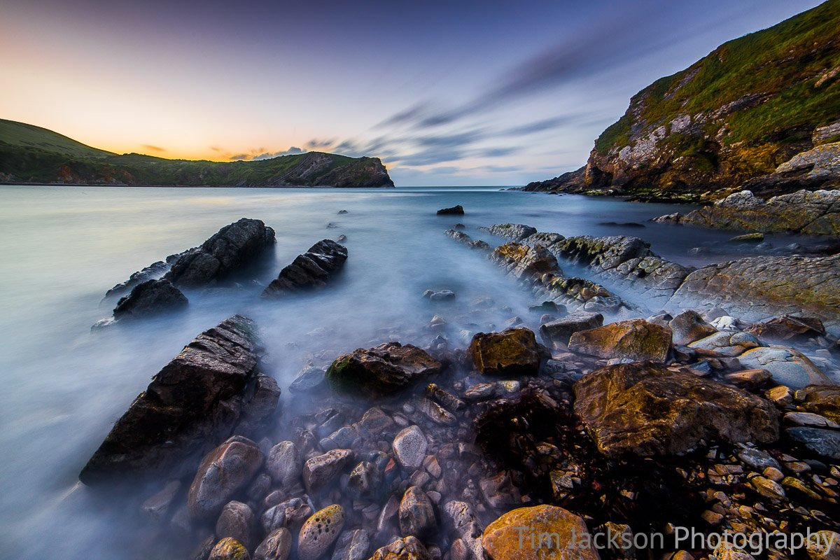 Dawn in Lulworth Cove Photograph by Tim Jackson