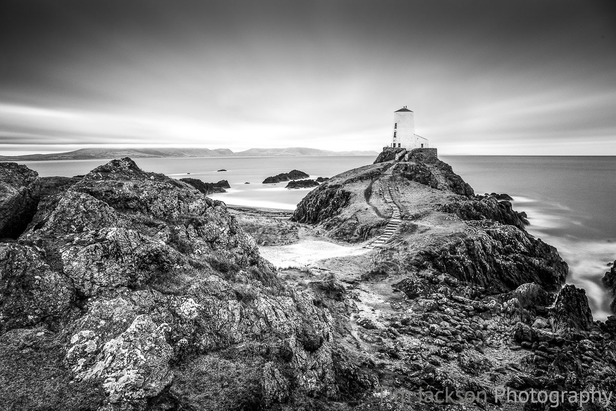 Do photographers miss out on enjoying the moment they are trying to capture? Llanddwyn Island Photograph by Tim Jackson