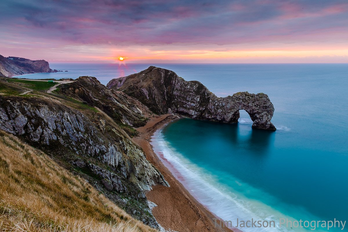 Durdle Door Sunrise Photograph by Tim Jackson