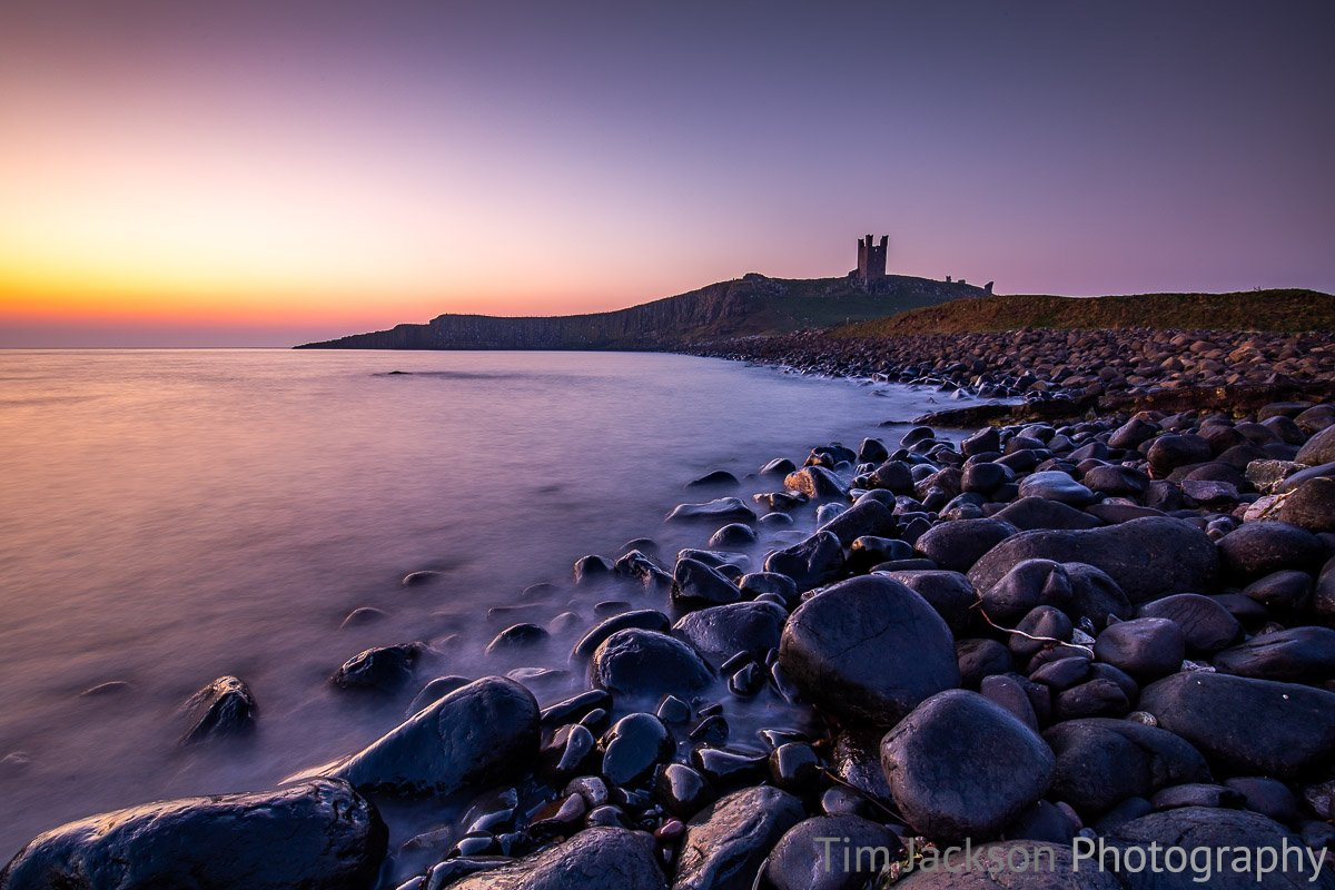Sunrise at Dunstanburgh Castle Sunrise at Dunstanburgh Castle Photograph by Tim Jackson