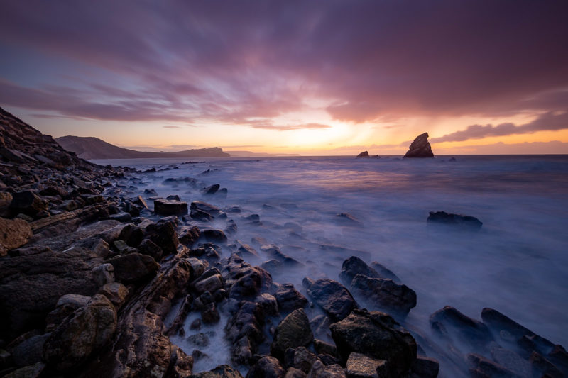 Mupe Bay Rain and Sunrise Mupe Bay Rain and Sunrise Photograph by Tim Jackson